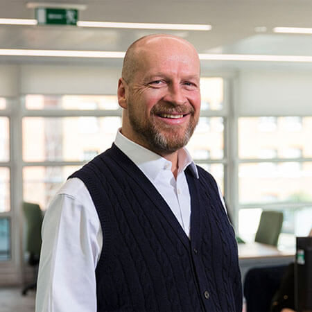 James Reed - CEO and Chairman of REED and reed.co.uk stood in office looking at camera
