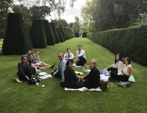 Learning and development page -learners in business school garden