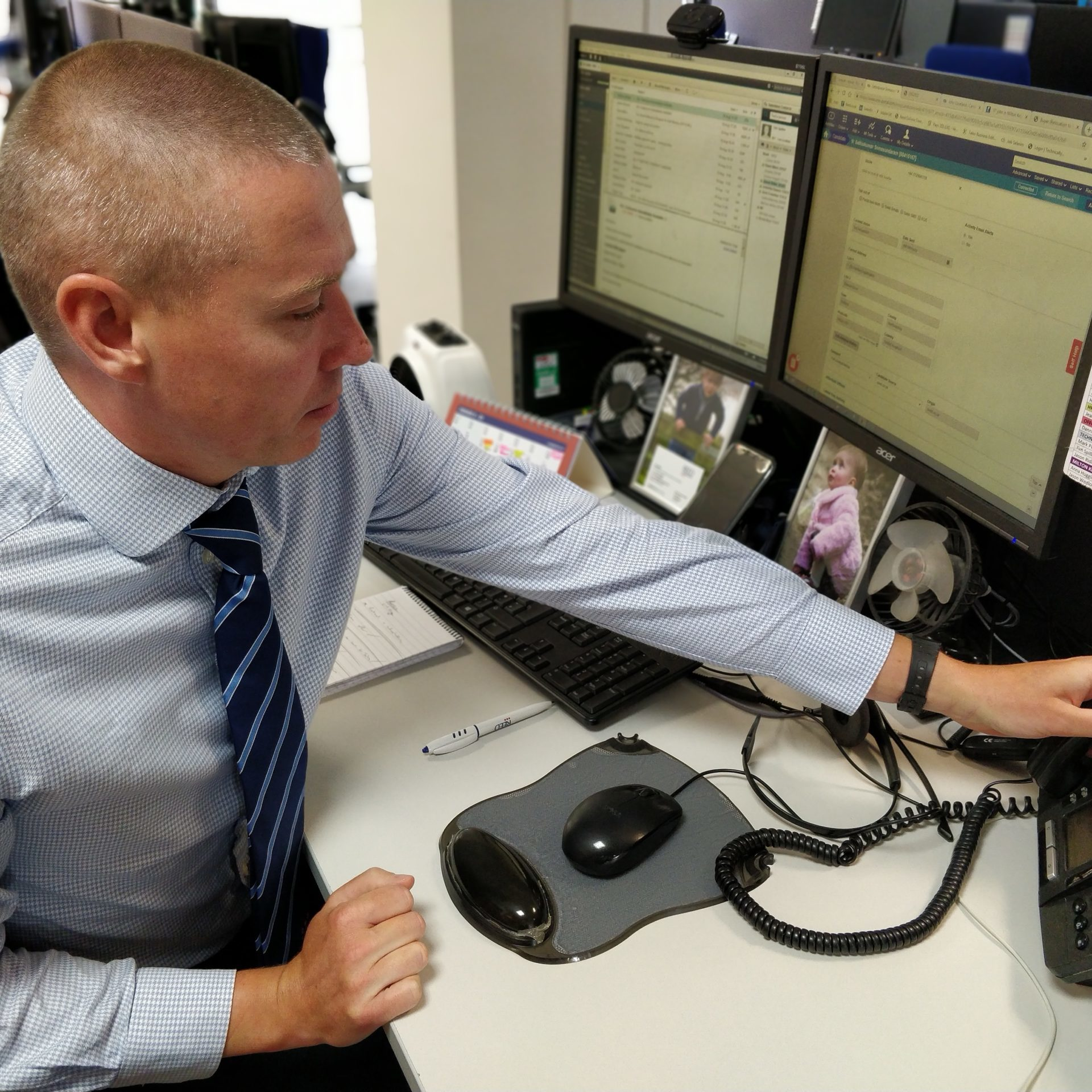 St Albans male recruitment consultant putting down phone