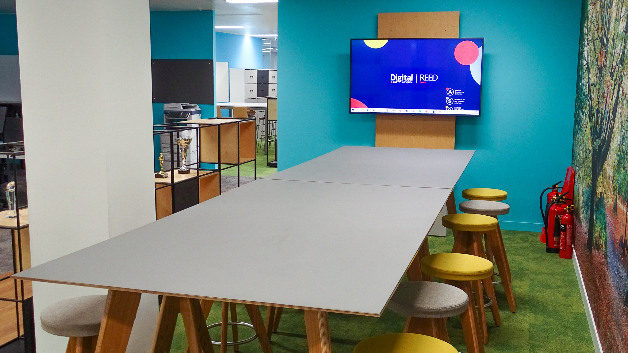 birmingham office sales meeting space - long table with stools next to a presentation screen