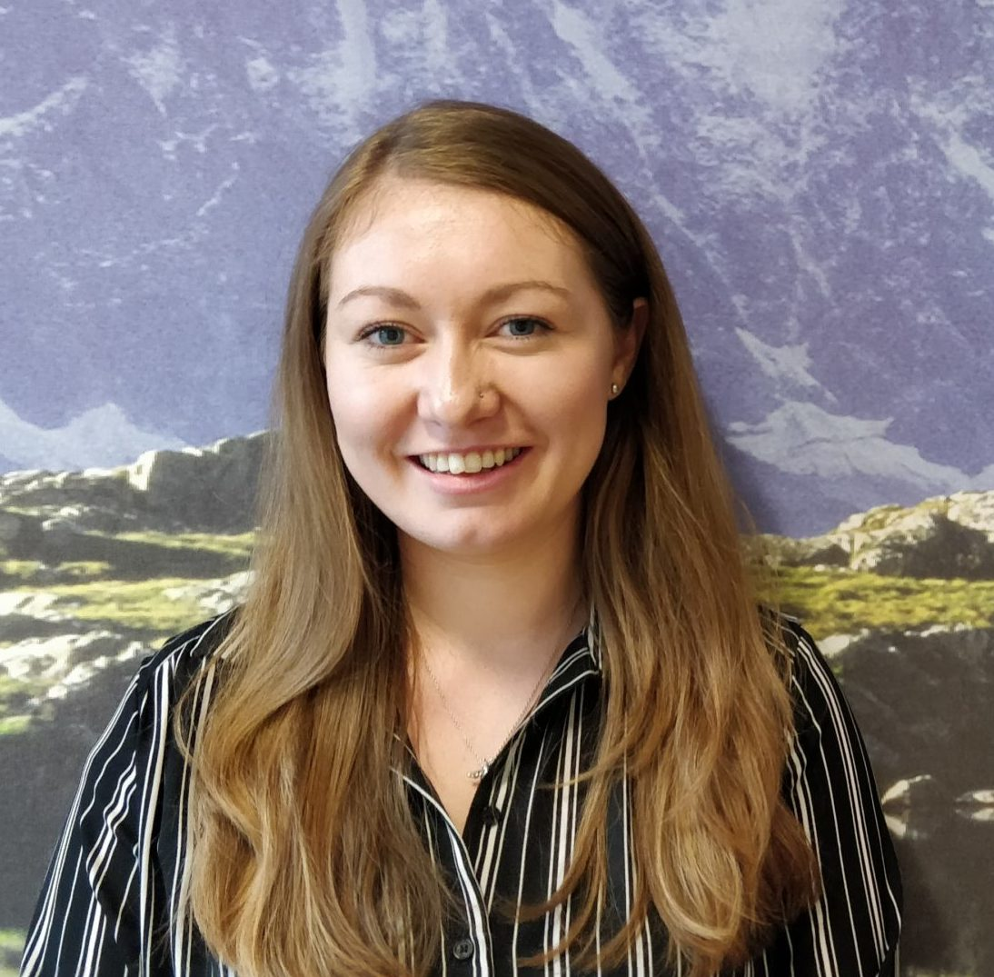Amy Cumberledge - DWP - Raynes Park - Engagement Consultant - stood in front of peaks wallpaper